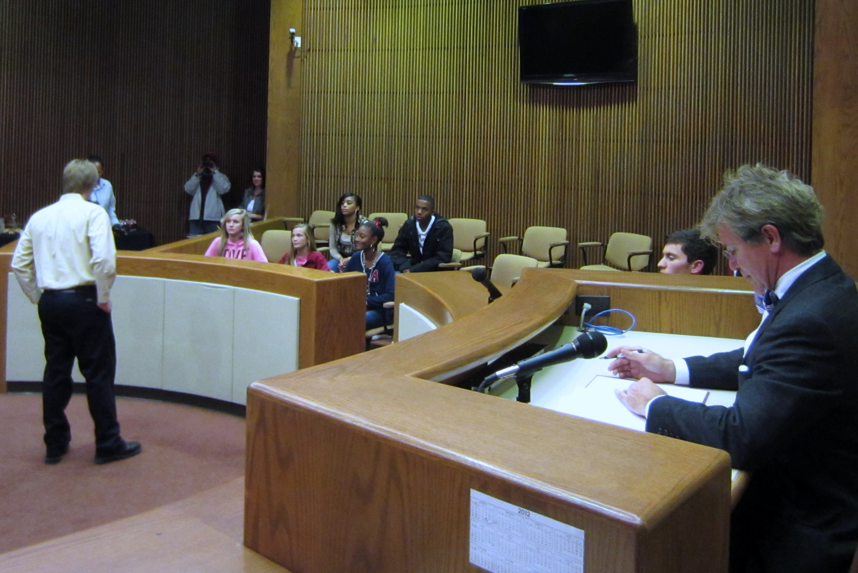 An attorney speaks to the teen jury