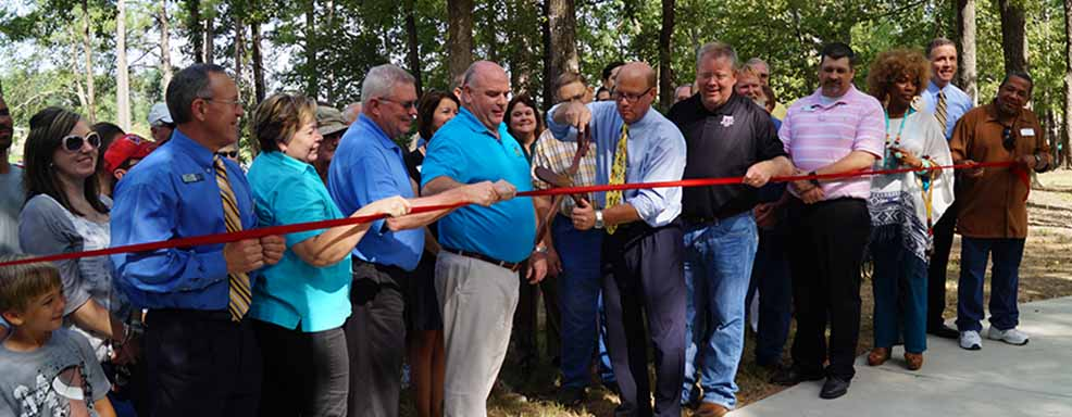 Peaple at a ribbon cutting